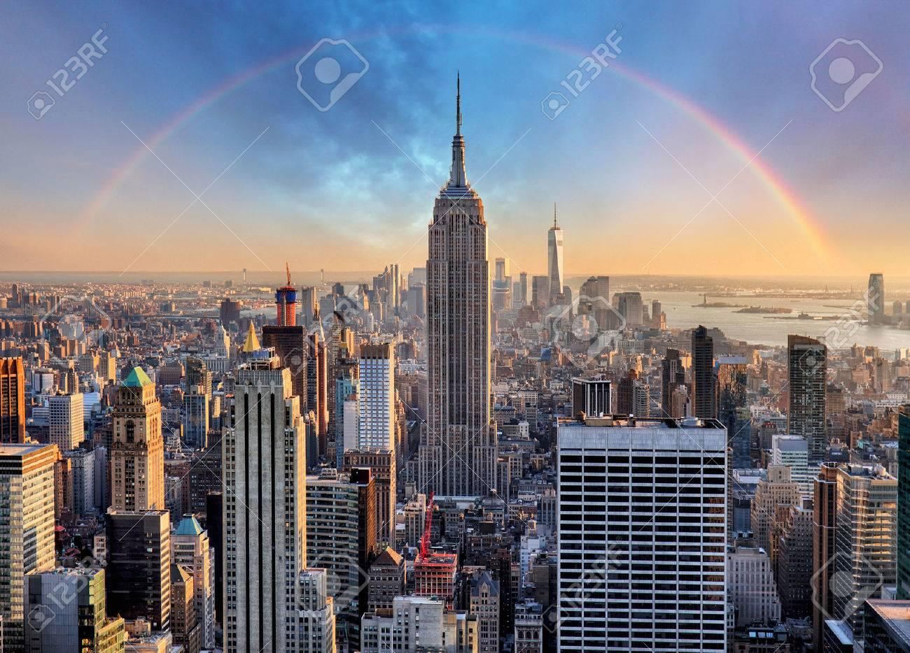 New York City skyline with urban skyscrapers and rainbow. - 57029801