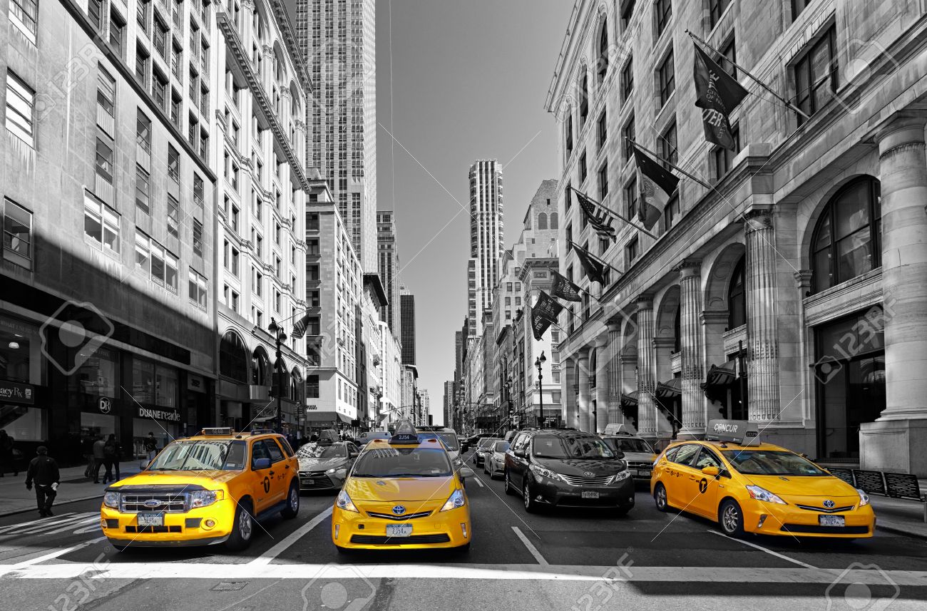 NEW YORK - APRIL 15: Yellow taxis rides on 5th Avenue on April 15 2016 in New York, USA. 5th Avenue is a central road of Manhattan, the most expensive shops and apartmens situated here - 59200225
