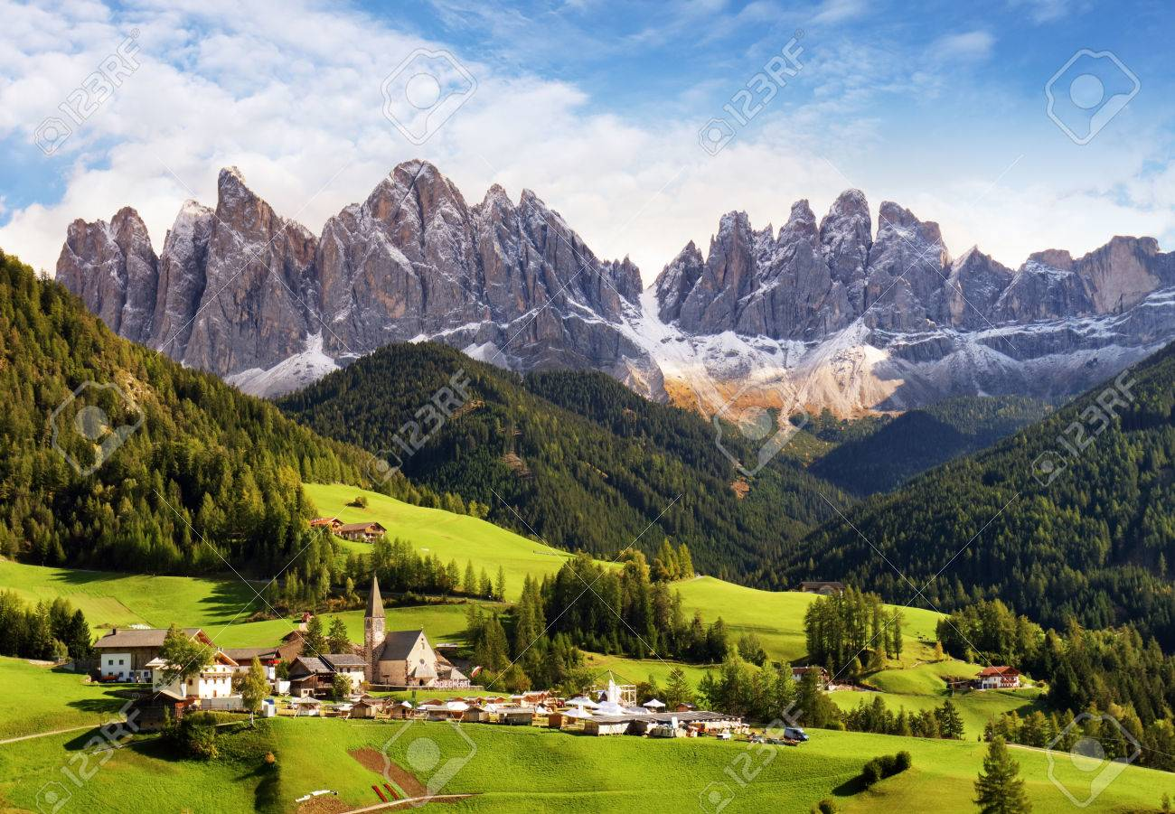 Val di Funes, Trentino Alto Adige, Italy. The great autumnal colors shines under the late sun with Odle on the background and Santa Magdalena Village on the foreground. - 66143059