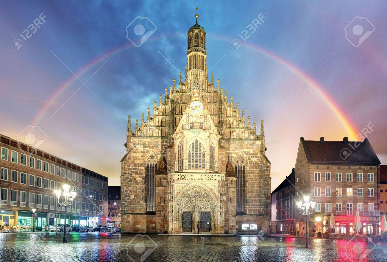 Nuremberg, cathedral Frauenkirche in Hauptmarkt wtih rainbow, Bavaria, Germany - 74989241