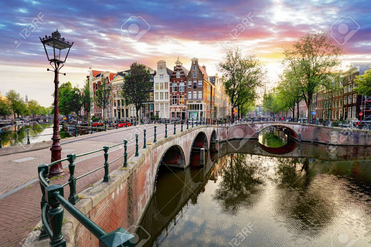 Amsterdam Canal houses at sunset reflections, Netherlands - 89361339