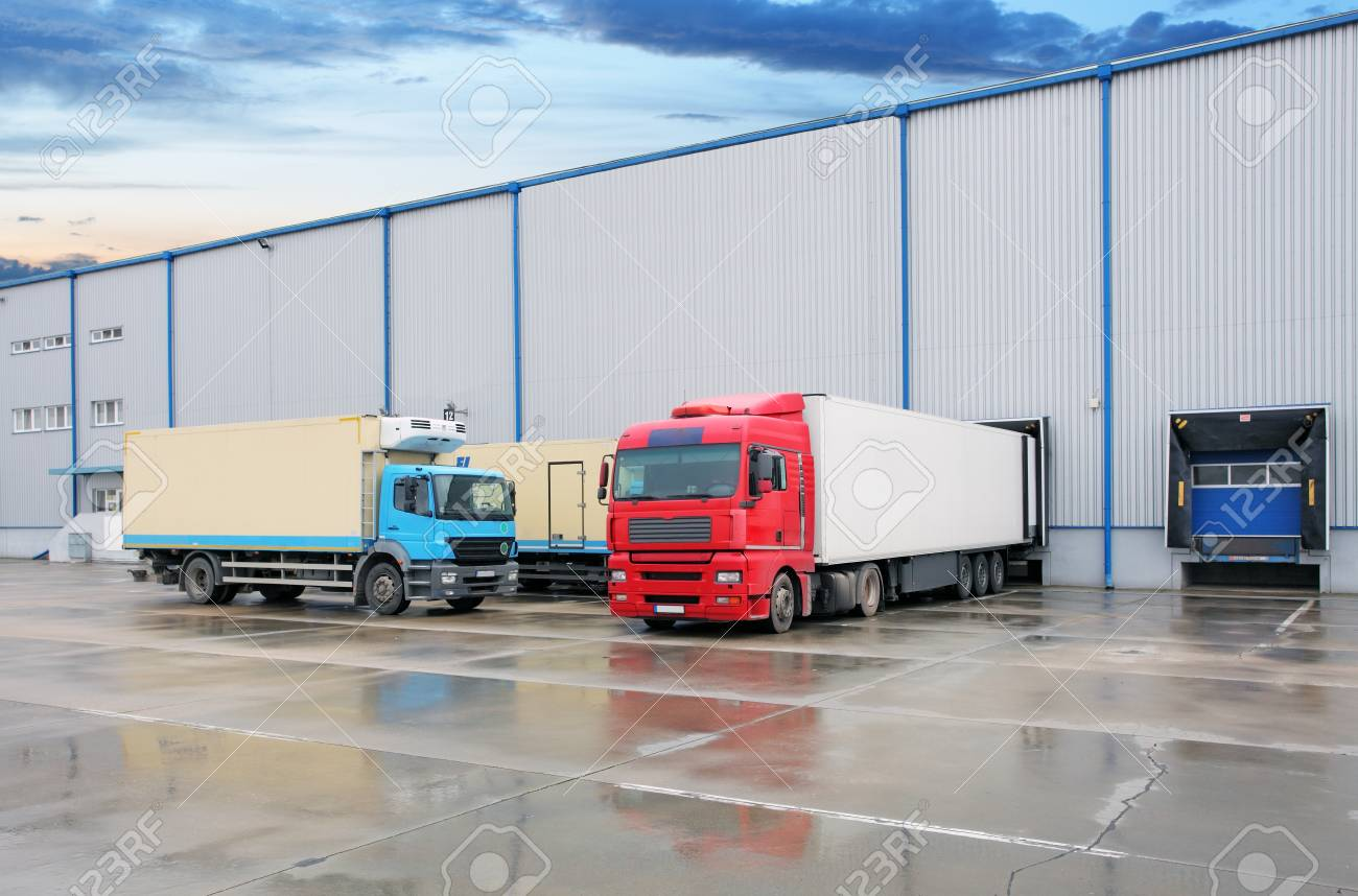Cargo truck at warehouse building - 94381466