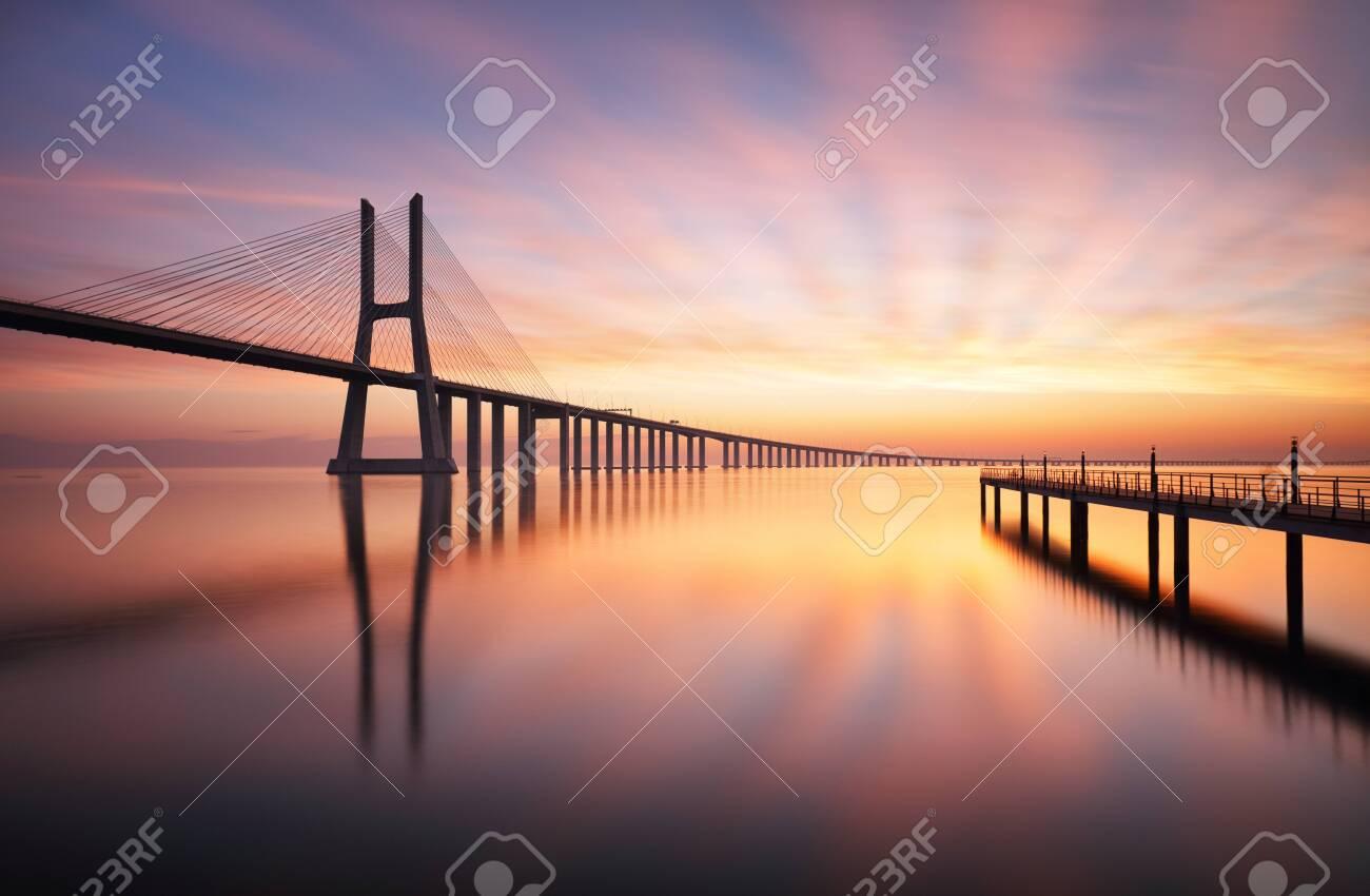 Lisbon bridge - Vasco da Gama at sunrise, Portugal - 126885952