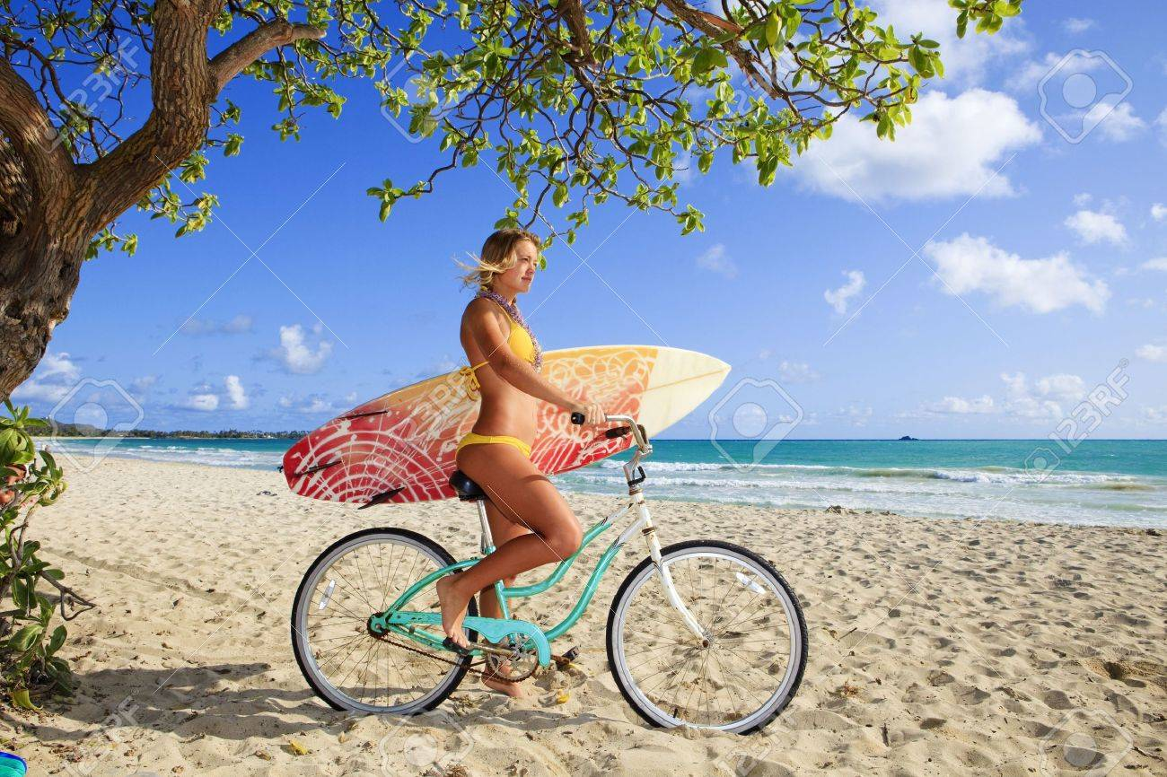 beautiful young girl on her bicycle with surfboard at kailua beach, hawaii Stock Photo - 6697296
