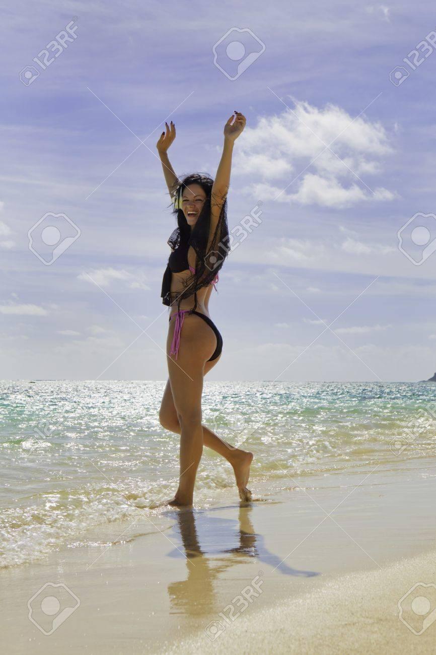 hispanic woman in bikini at a hawaii beach Stock Photo - 9828794