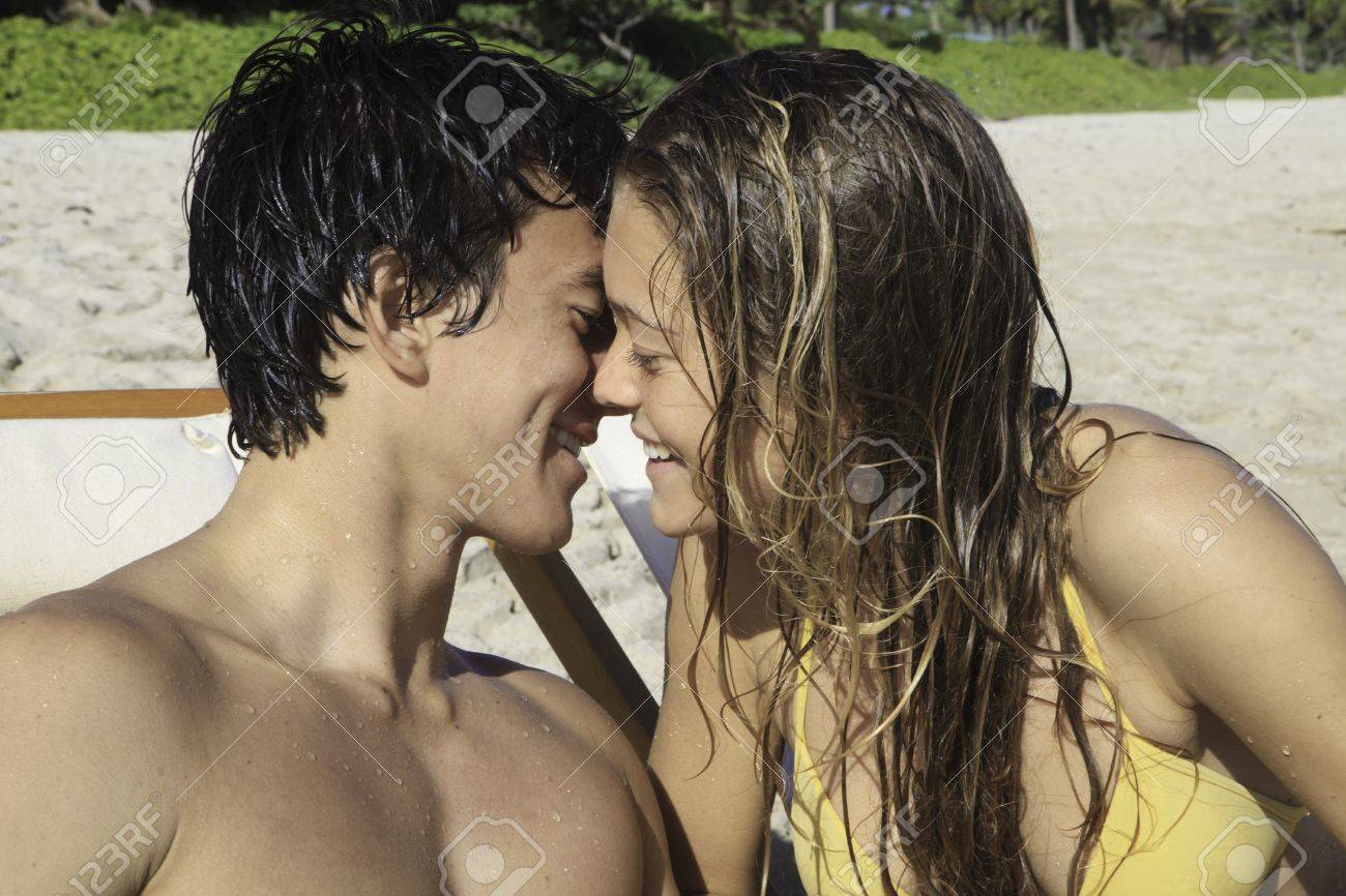 young couple kissing at the beach in hawaii Stock Photo - 12137238