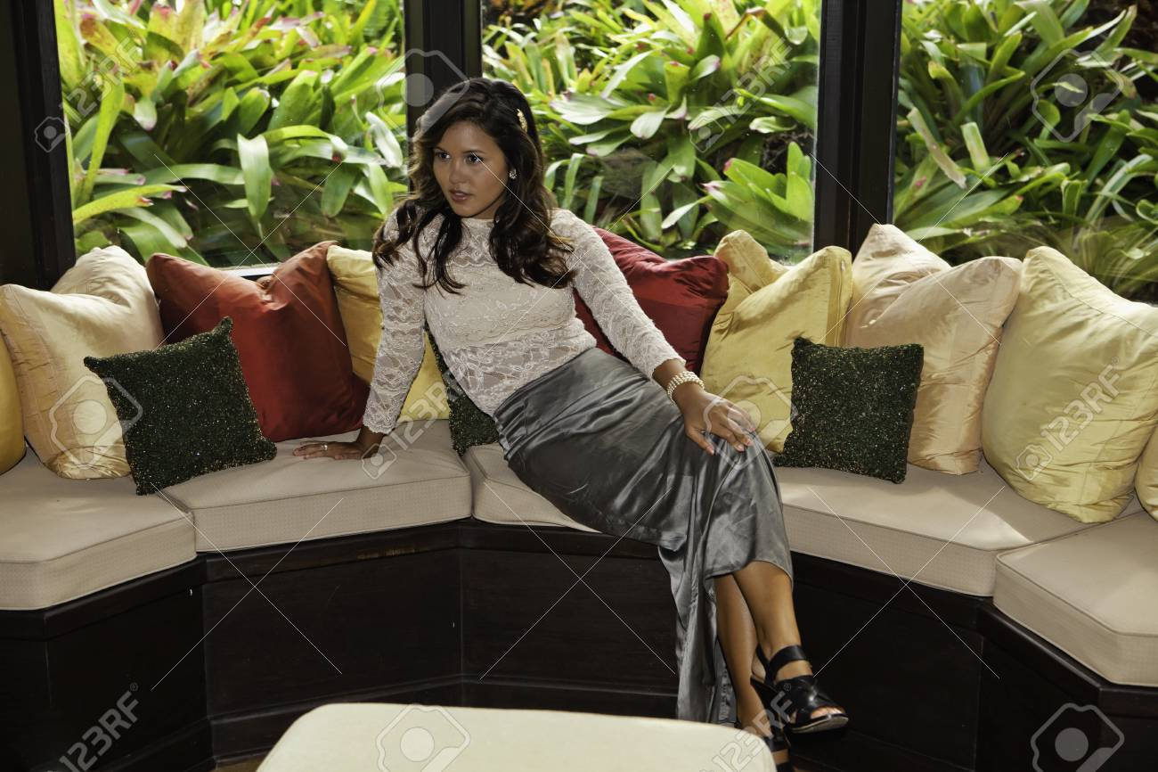 polynesian woman on her living room sofa Stock Photo - 12449554