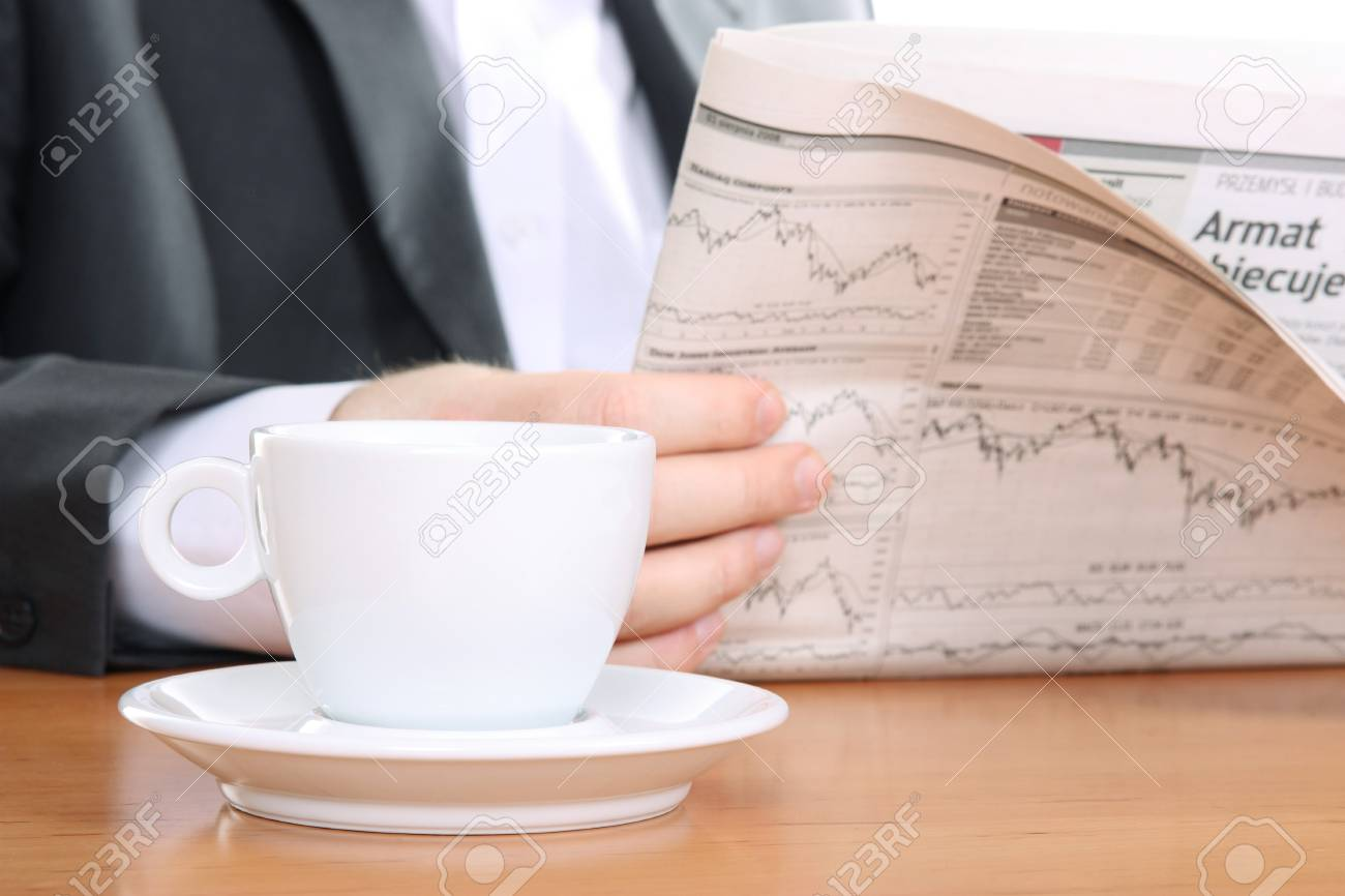 businessman read business news and drinking coffee Stock Photo - 4100106
