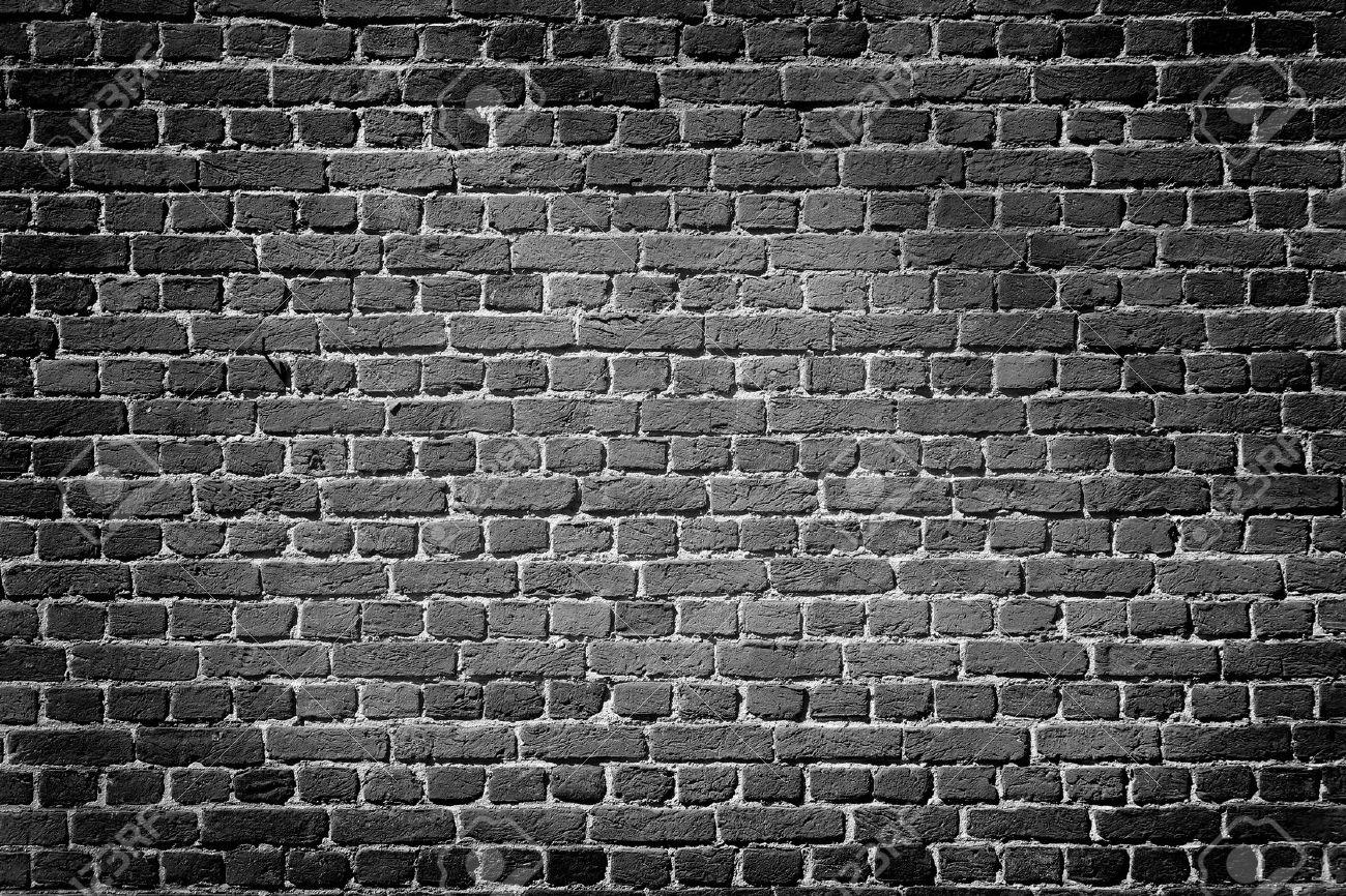 Old Dark Brick Wall Texture Background Stock Photo
