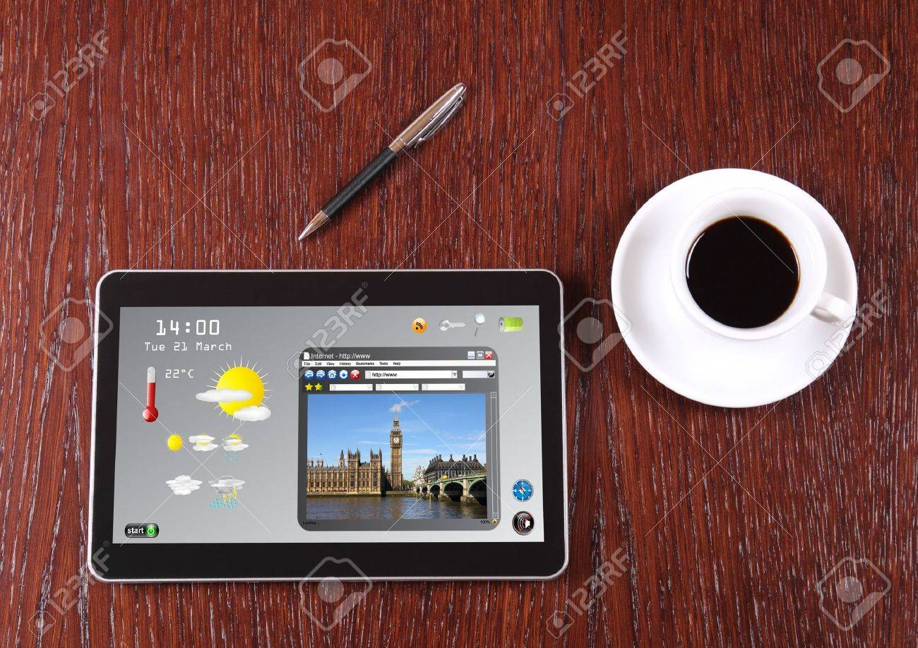Tablet, coffee and pen on the desk Stock Photo - 15121796