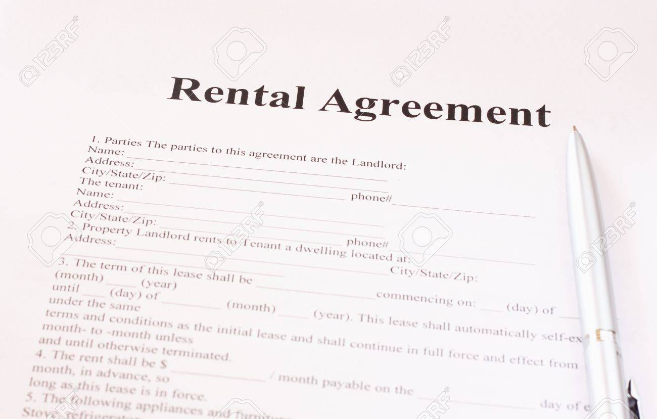 Exclusivity Agreement Form With Pen And Glasses