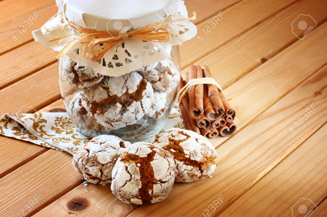 Honey Cakes Cookie Jar And Cinnamon Sticks On Wooden Table