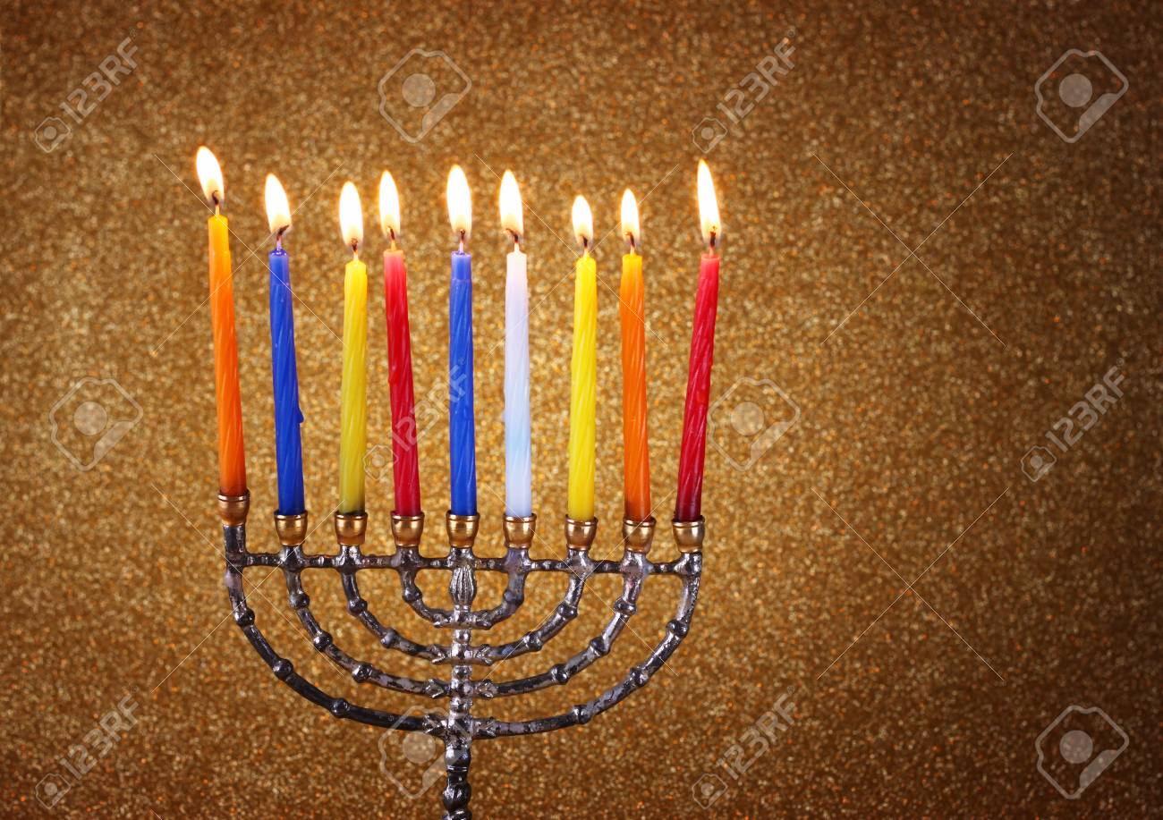Hanukkah menorah over glitter background Stock Photo - 23414407