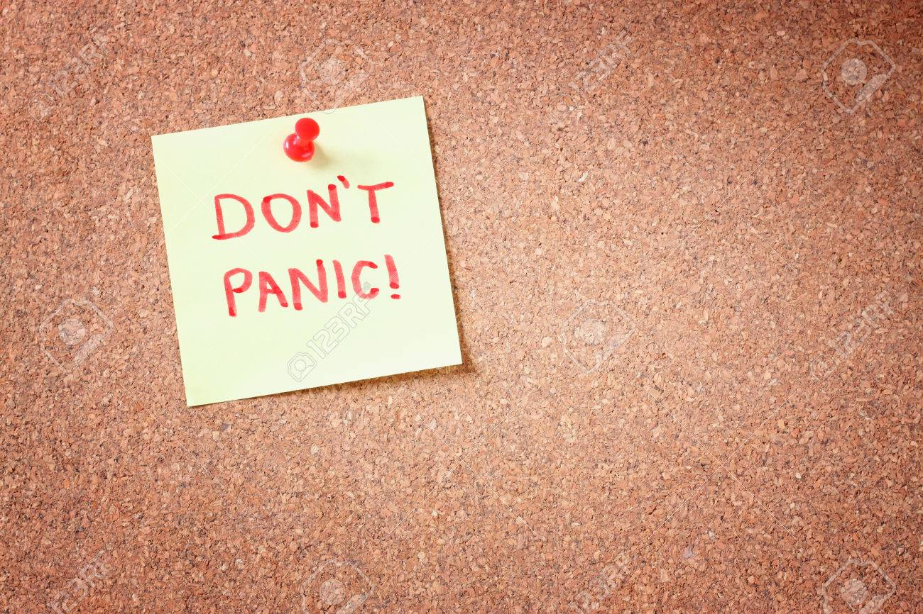 cork board with pinned yellow note and the phrase dont panic written on it room for text - 24420571