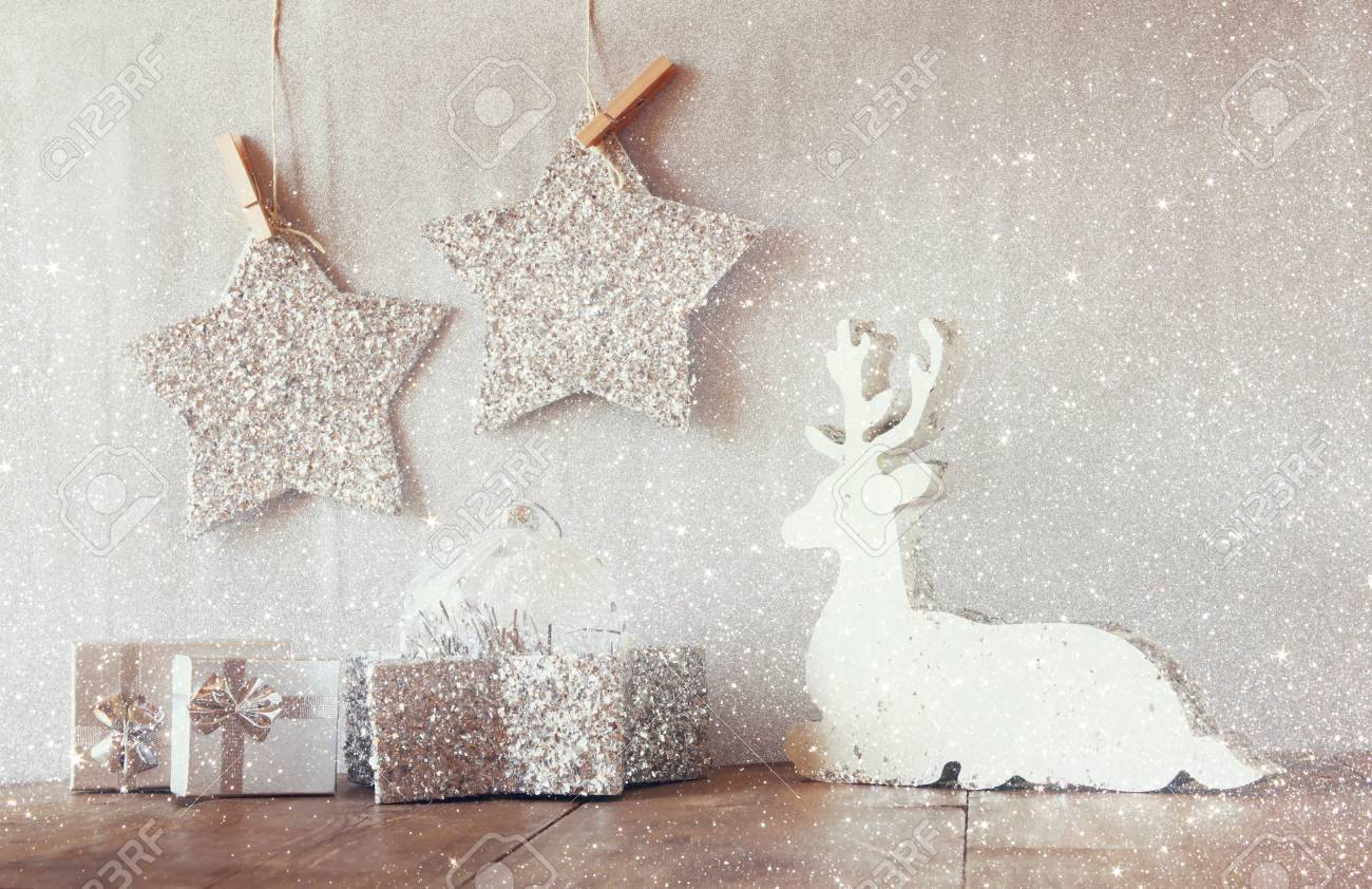 Image Of White Wooden Reindeer And Glitter Stars Hanging On Rope
