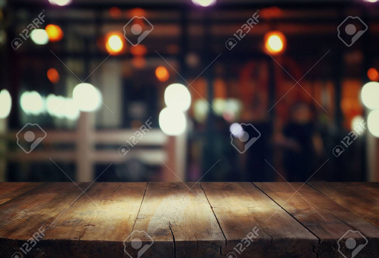Bar Table: Image Of Wooden Table In Front Of Abstract Blurred Background Of  Restaurant Lights