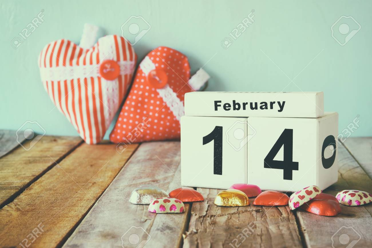 February 14th wooden vintage calendar with colorful heart shape