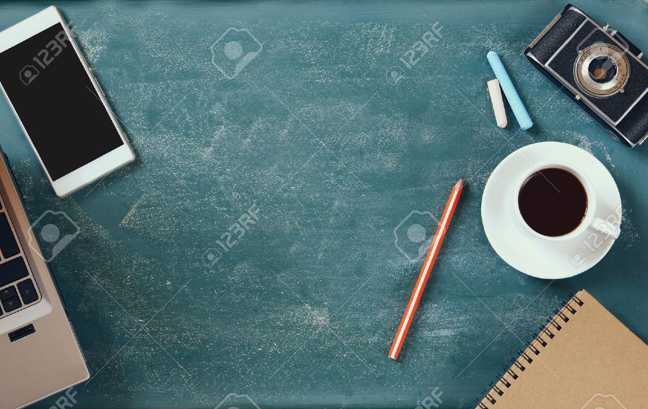 top view image of mobile phone, cup of coffee and laptop over blackboard background - 51155993