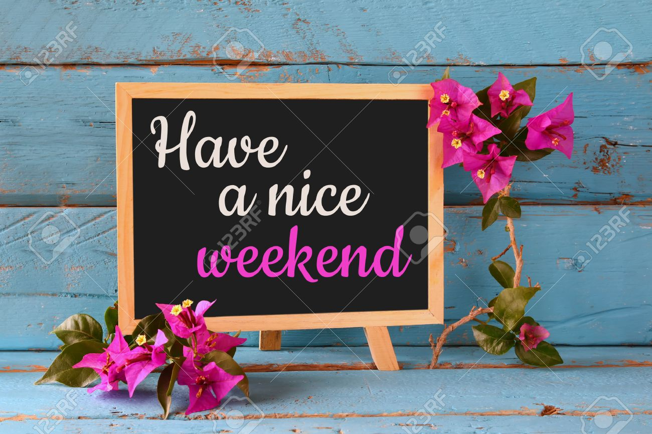 blackboard over blue wooden shelf with the phrase have a nice weekend stock photo 53379544