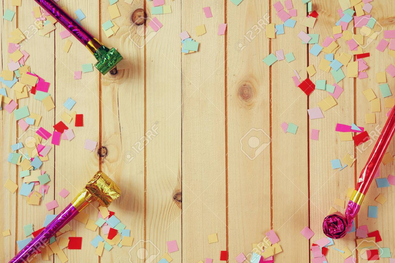 party background with colorful confetti and party whistle Stock Photo - 53608375