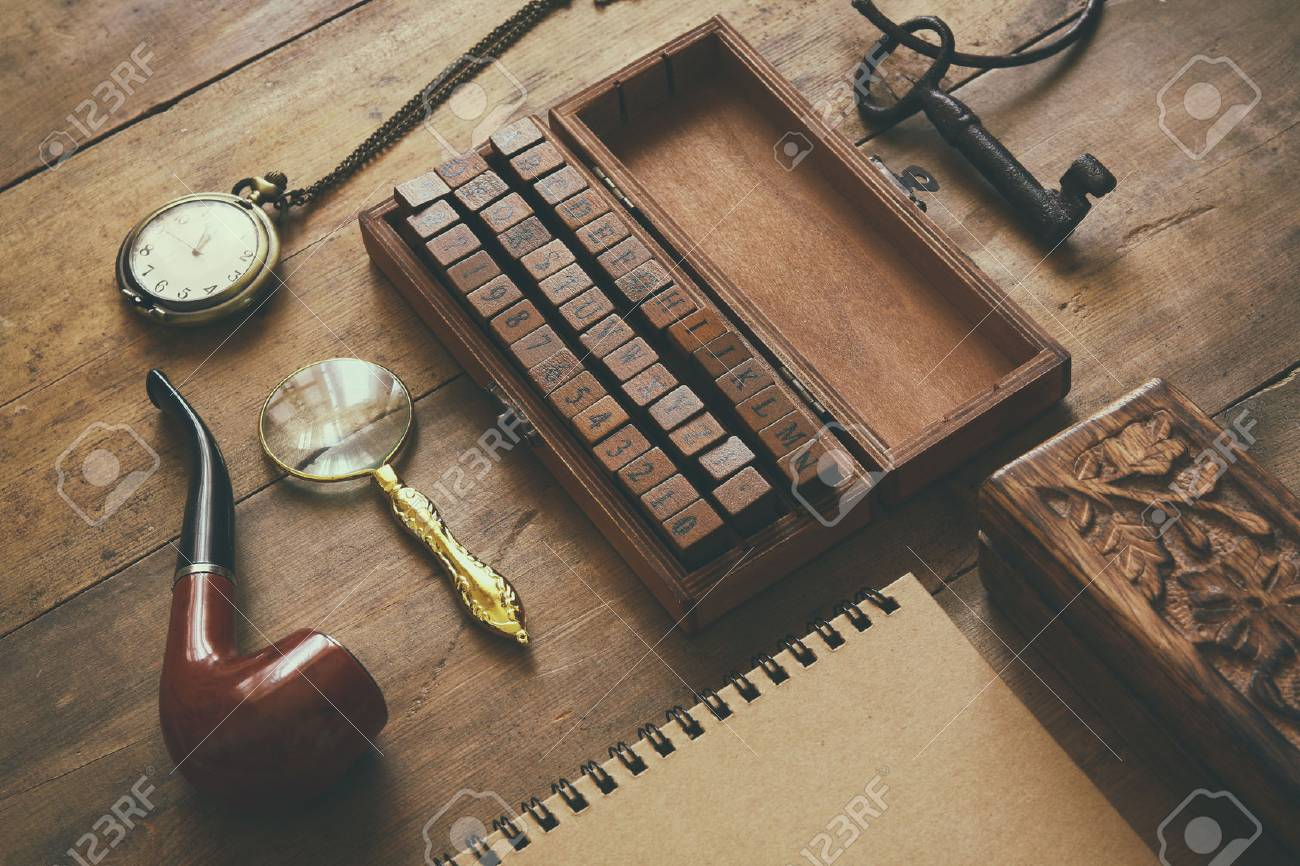 detective concept. Private Detective tools: magnifier glass, old keys, smoking pipe, notebook. top view. vintage filtered image Stock Photo - 53608382
