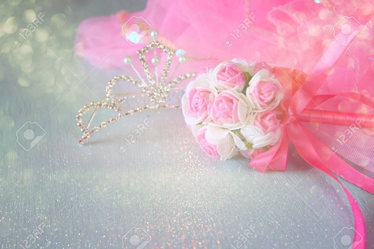 Small Girls Party Outfit Crown And Wand Flowers On Wooden Table