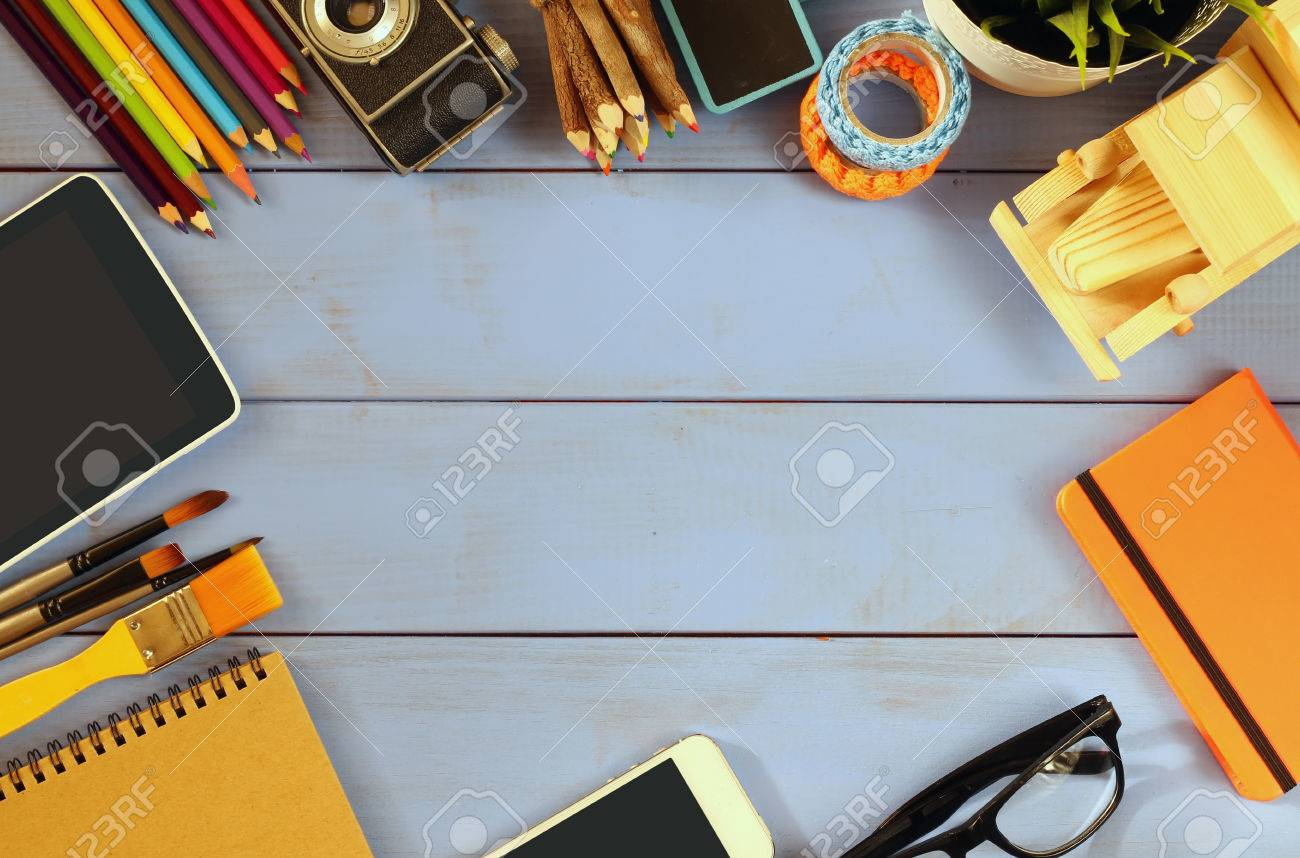 16ddf9c0d0f2c top view photo of business and school supplies on wooden table...