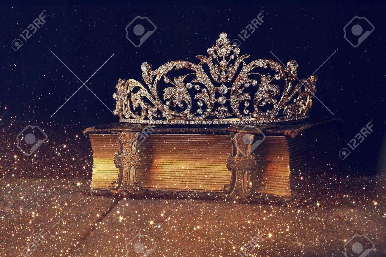 low key image of beautiful diamond queen crown on old book. vintage filtered. selective focus Stock Photo - 55592525