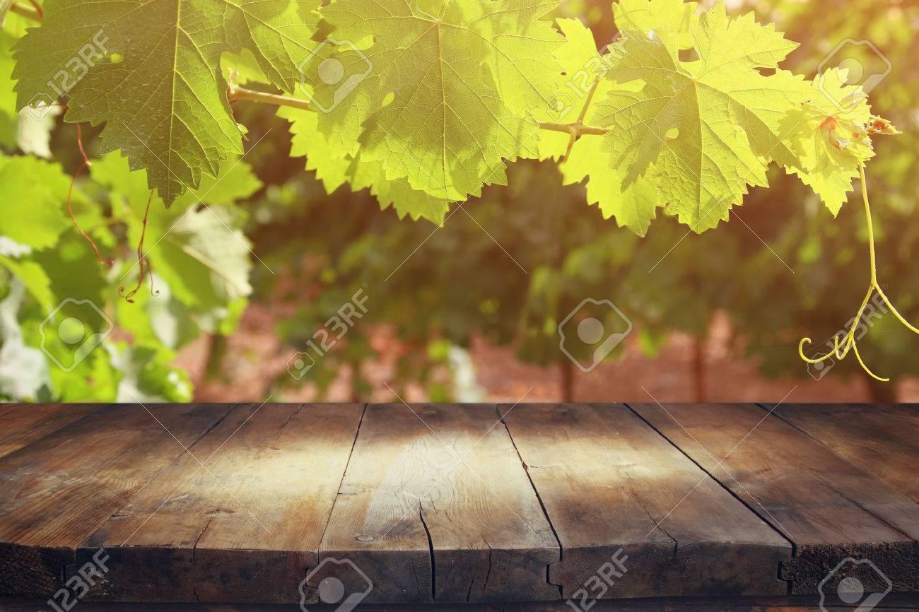 image of wooden table in front of Vineyard landscape. vintage filtered Stock Photo - 57069603