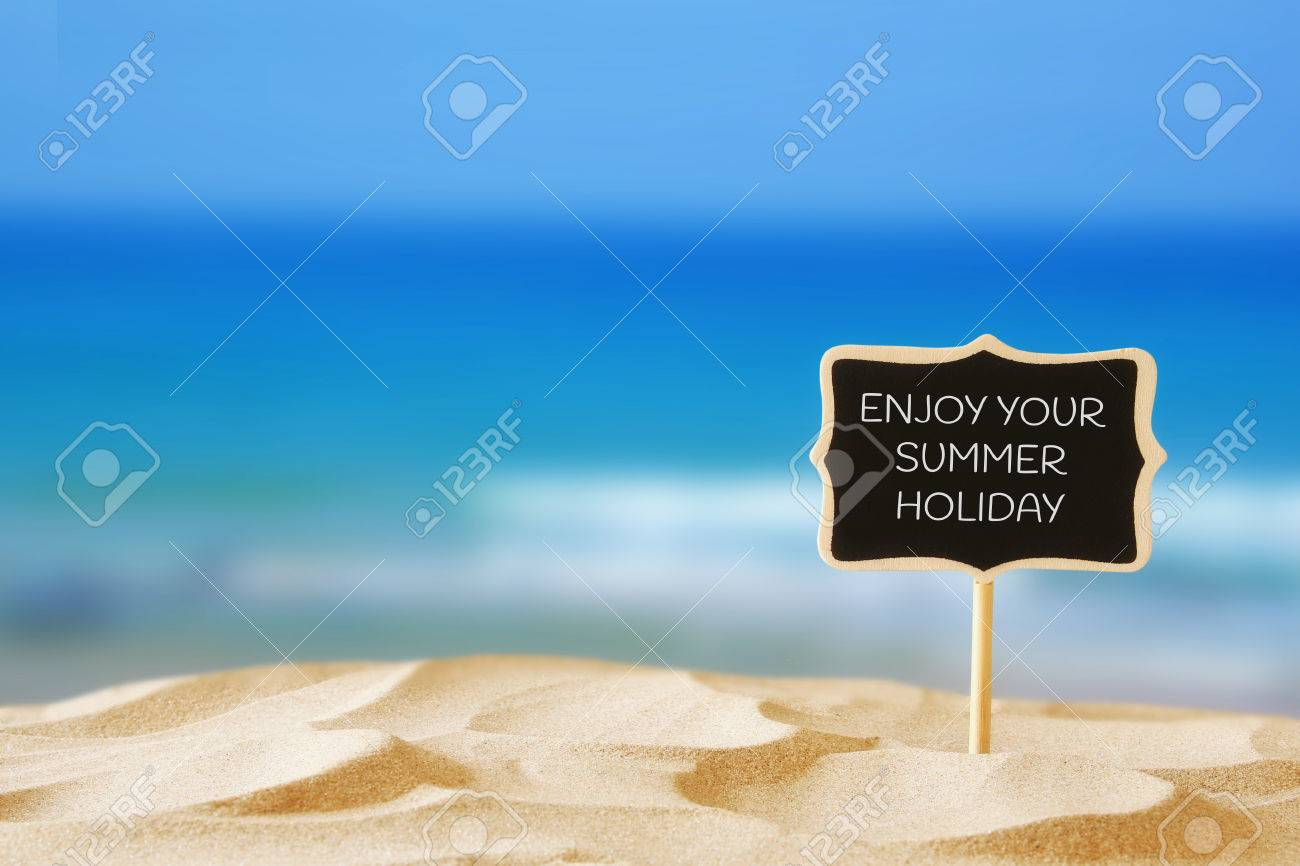 Image Of Tropical Sandy Beach And Blank Wooden Chalkboard Sign With Quote:  ENJOY YOUR SUMMER
