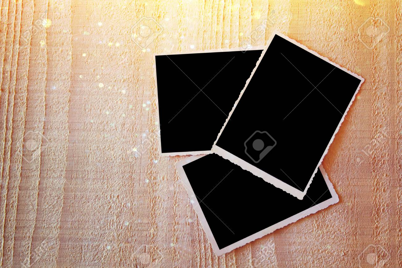Top View Of Blank Photos Frame On Wooden Background Vintage