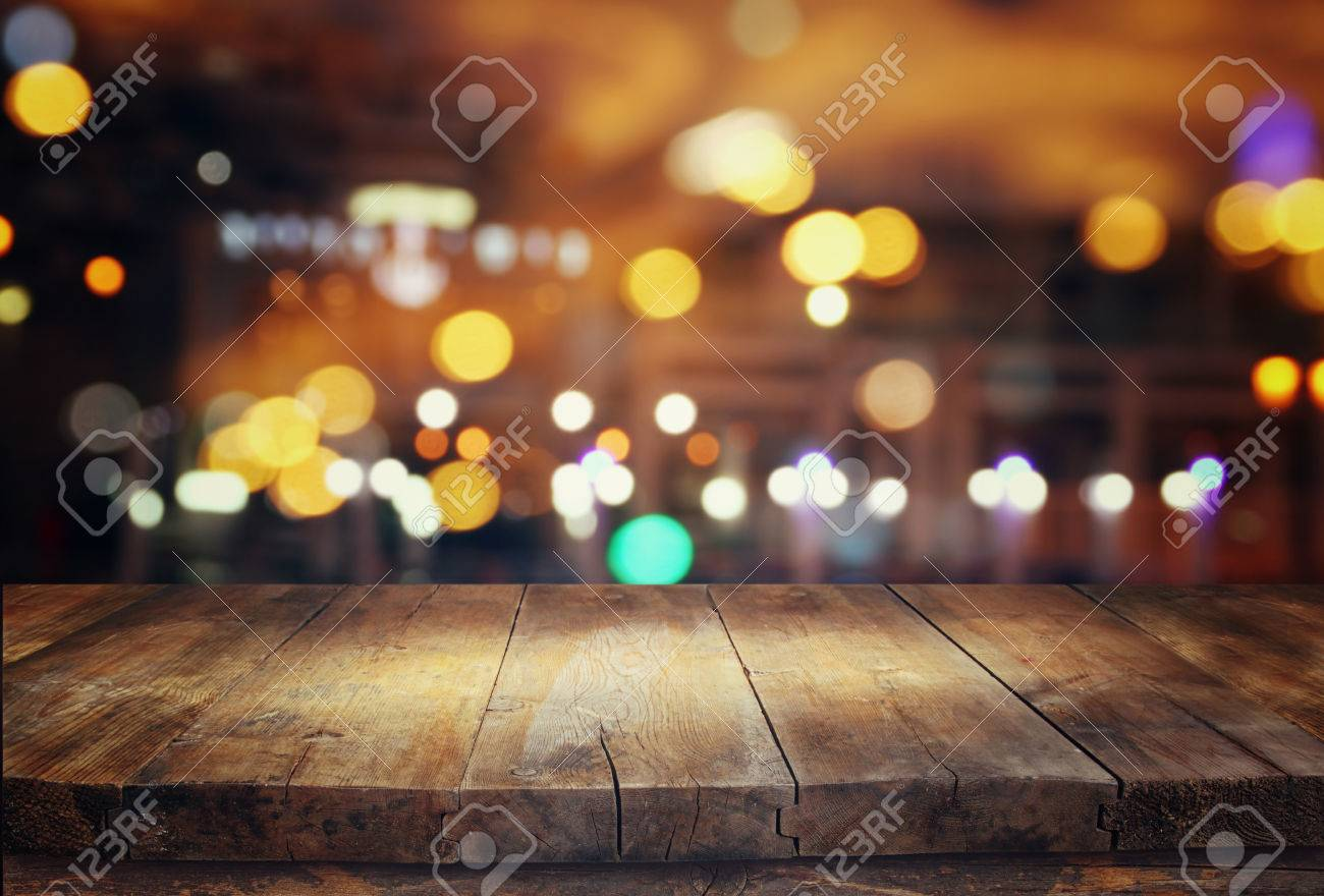 Image of wooden table in front of abstract blurred restaurant lights background - 63818918