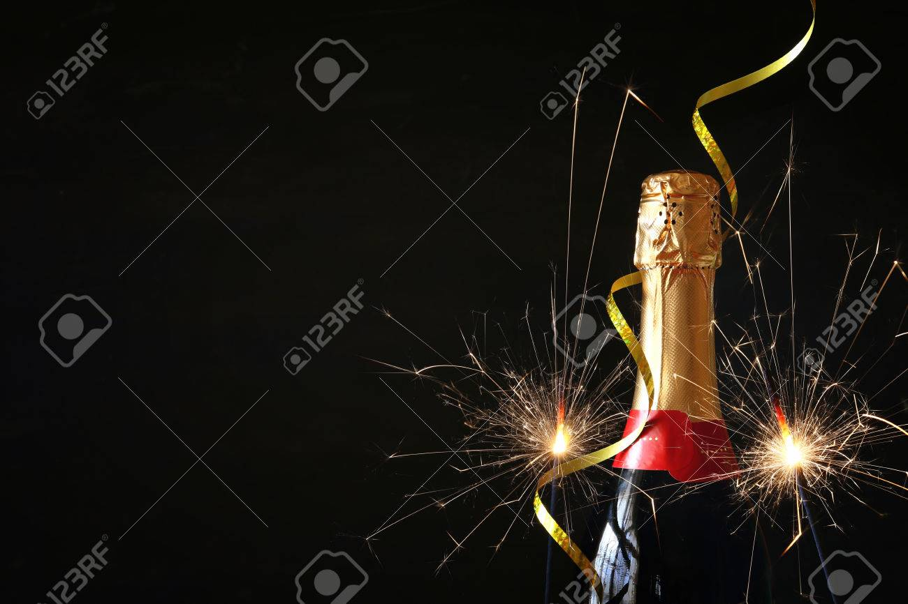 Champagne bottle in front of black background. New year and celebration concept Stock Photo - 63870753