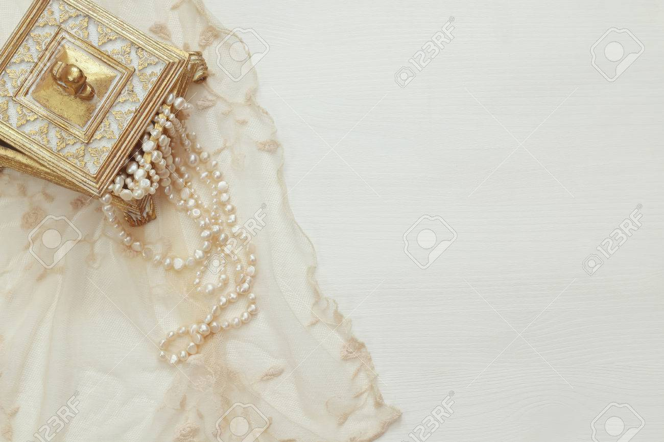 Top view image of white pearls necklace. Stock Photo - 64554899