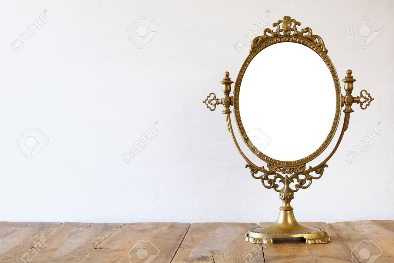 Old Vintage Oval Mirror Standing On Wooden Table Stock Photo Picture And Royalty Free Image Image 65645664