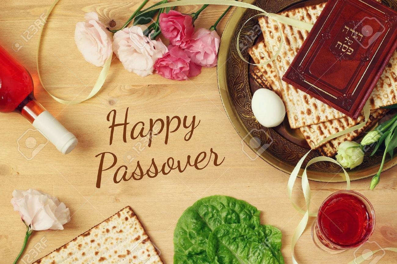 Pesah celebration concept (jewish Passover holiday). Traditional book with text in hebrew: Passover Haggadah (Passover Tale) Stock Photo - 71673046