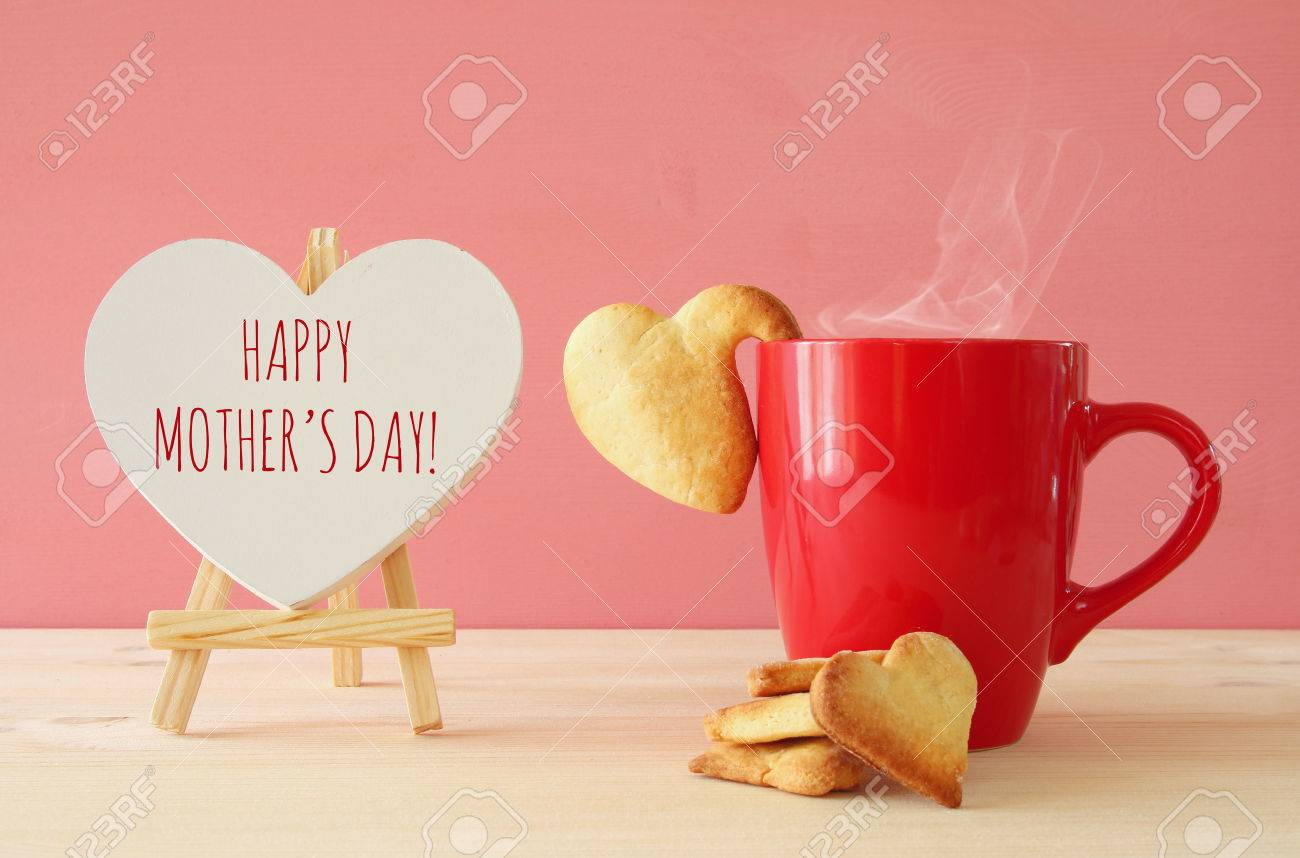 mother's day concept image. Board next to cup of coffee and heart cookies Stock Photo - 72583032