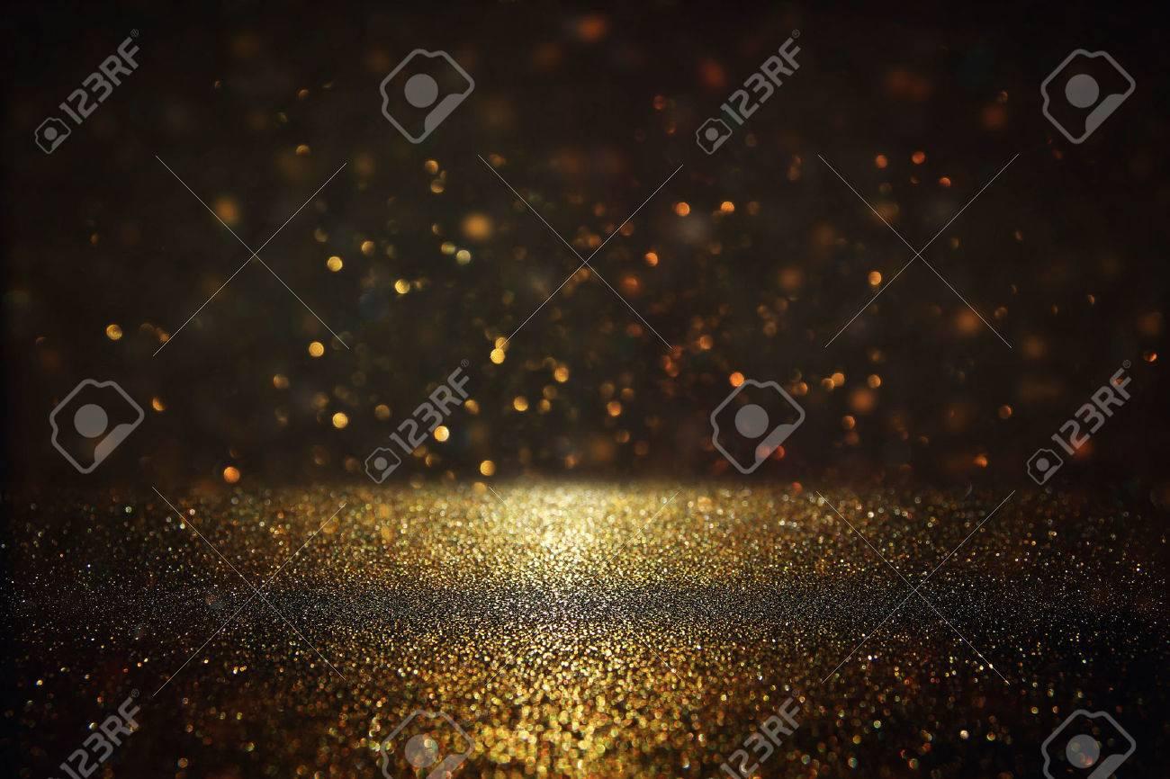 glitter vintage lights background. gold and black. de-focused. Stock Photo - 75761141