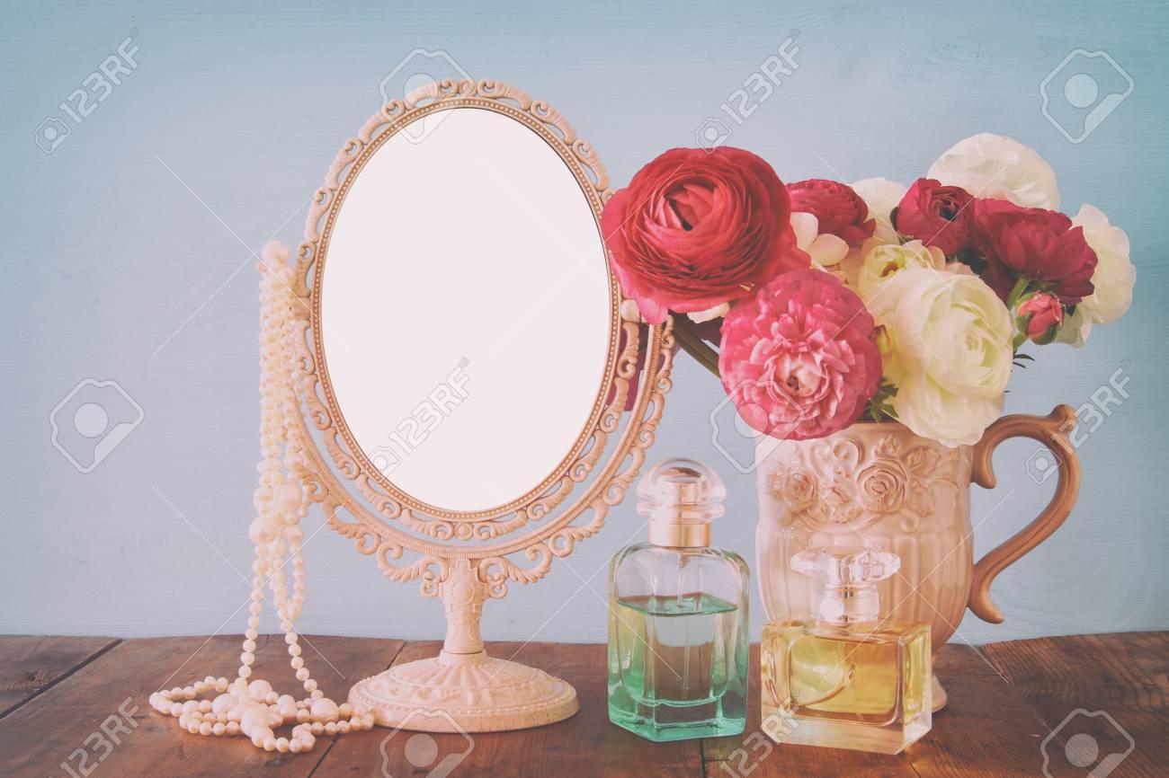 Image of beautiful bouquet of spring flowers perfume bottle stock image of beautiful bouquet of spring flowers perfume bottle and pearls next to blank vintage mightylinksfo