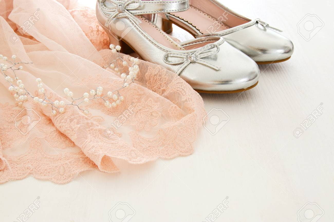 peach dress with silver shoes