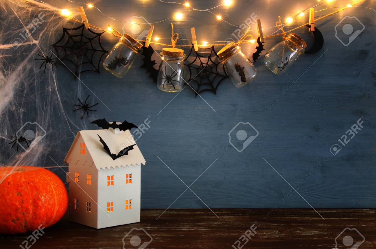 Halloween Holiday Concept. Mysterious House With Lights In Front ...