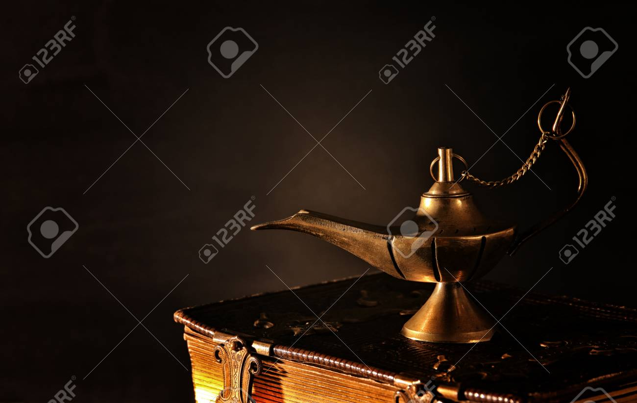 Image of magical magic lamp on old books  Lamp of wishes