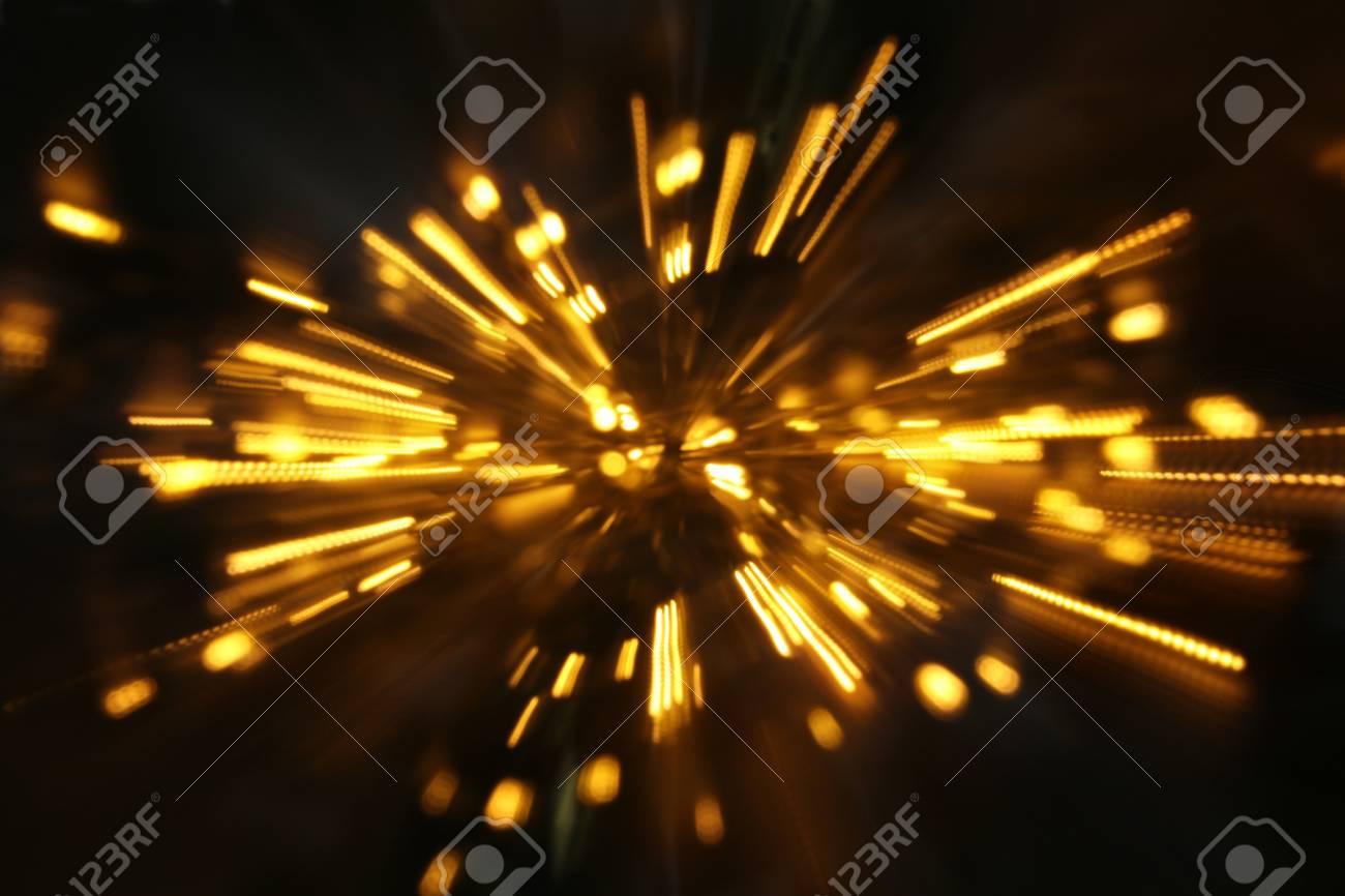 abstract bokeh background of golden light burst made from bokeh