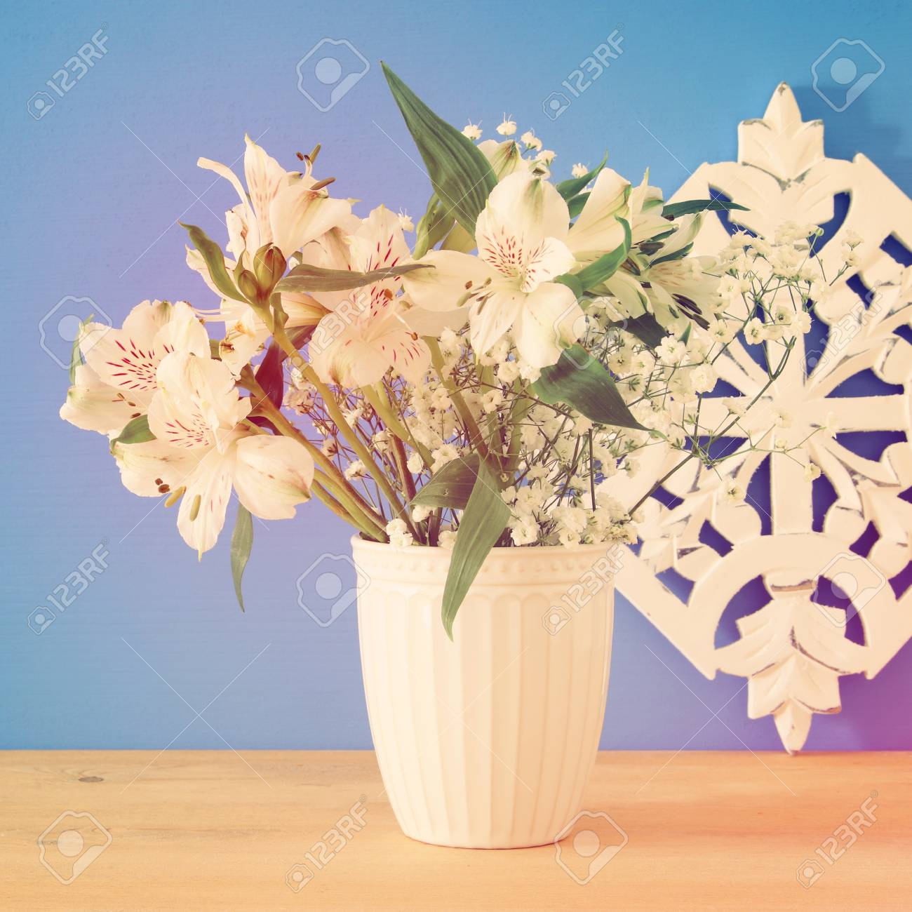 Summer bouquet of white flowers in the vase over wooden table stock photo summer bouquet of white flowers in the vase over wooden table and blue background mightylinksfo