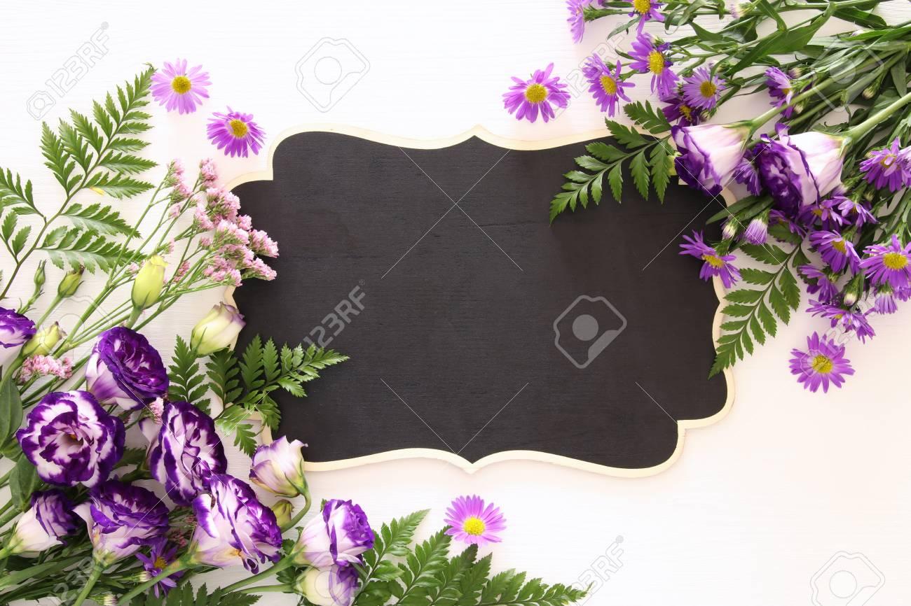 Top View Of Purple Beautiful Flowers Arrangement And Empty