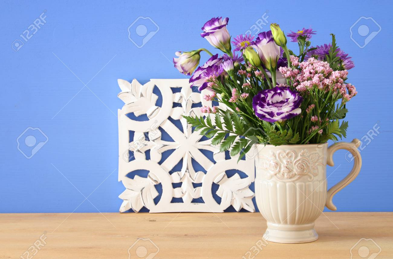 Summer Bouquet Of Purple Flowers In The Vase Over Wooden Table ...