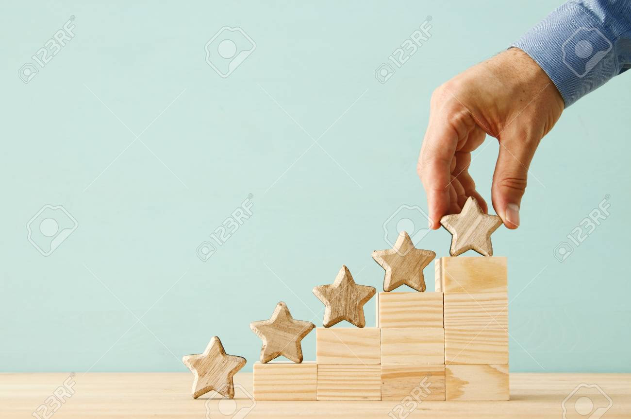 concept image of setting a five star goal. increase rating or ranking, evaluation and classification idea - 105228376