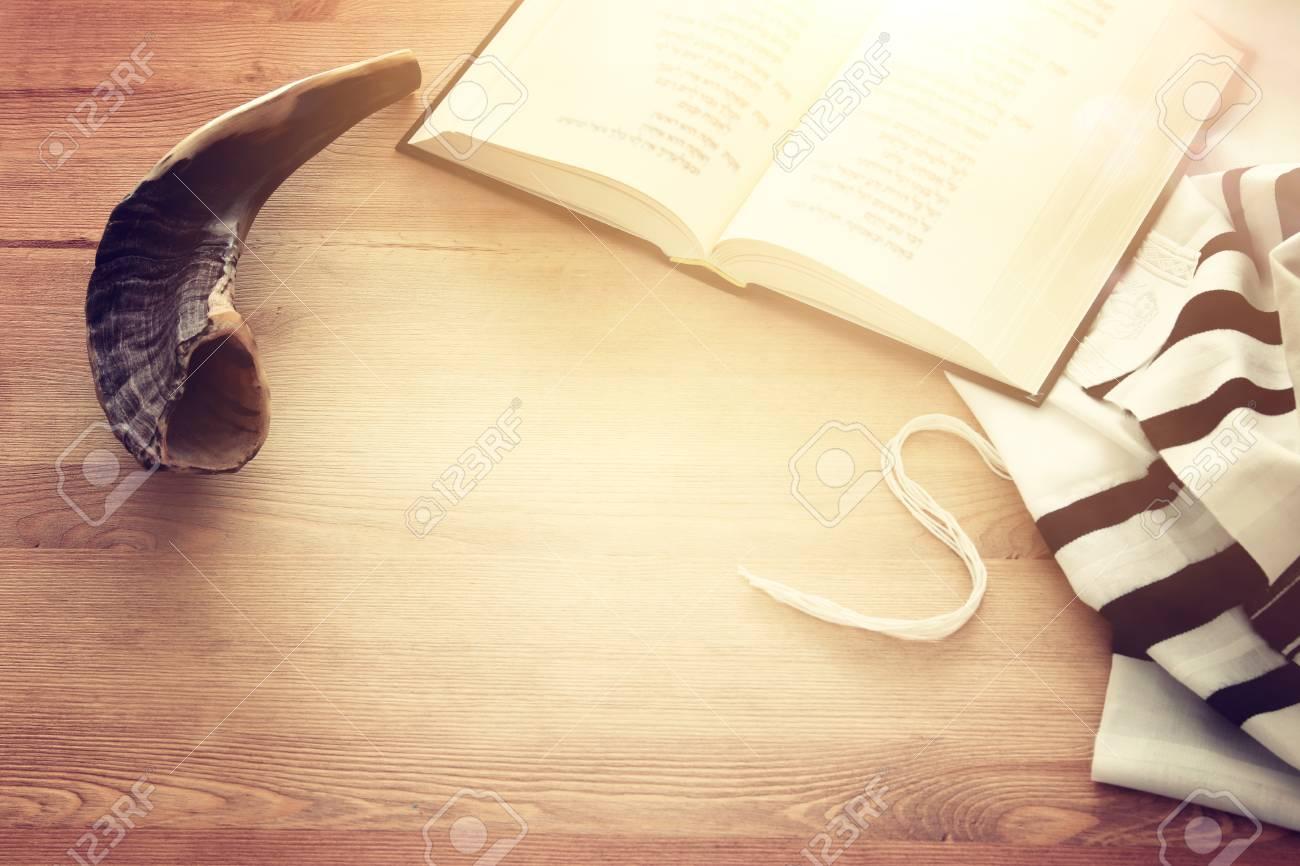 Prayer Shawl - Tallit, Prayer book and Shofar (horn) jewish religious symbols. Rosh hashanah (jewish New Year holiday), Shabbat and Yom kippur concept. - 106250720