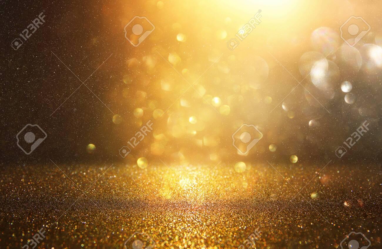 glitter vintage lights background. black and gold. de-focused - 108570983
