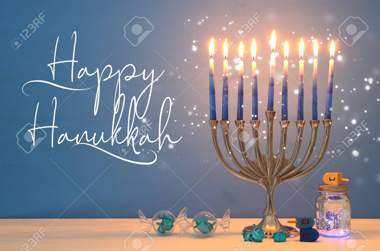 image of jewish holiday Hanukkah background with menorah (traditional candelabra) and candles - 110259844